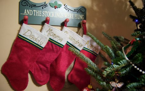 Stockings lined up along the wall ready to get stuffed! Photo via Flickr under the Creative Common License.