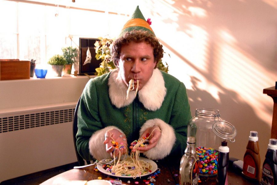 Will Ferrell, as Buddy the elf, eating spaghetti with various condiments.