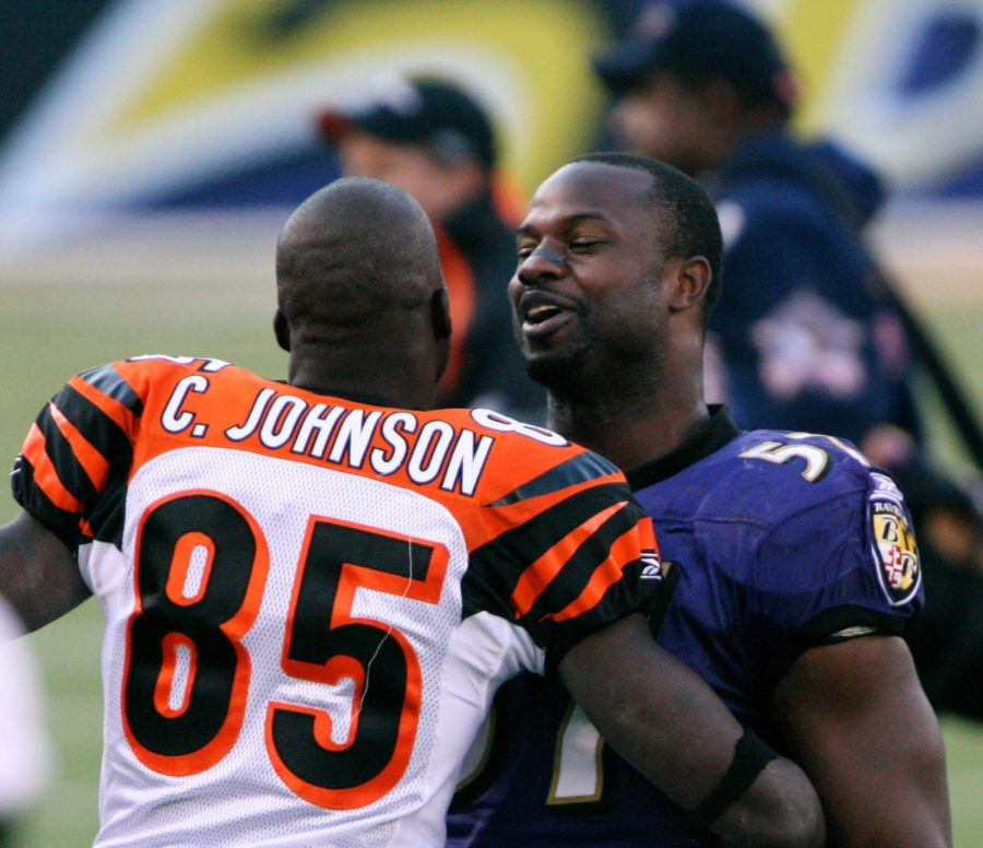Seen here is former NFL superstar Chad Johnson (#85, left) hugging his opponent after a game.
