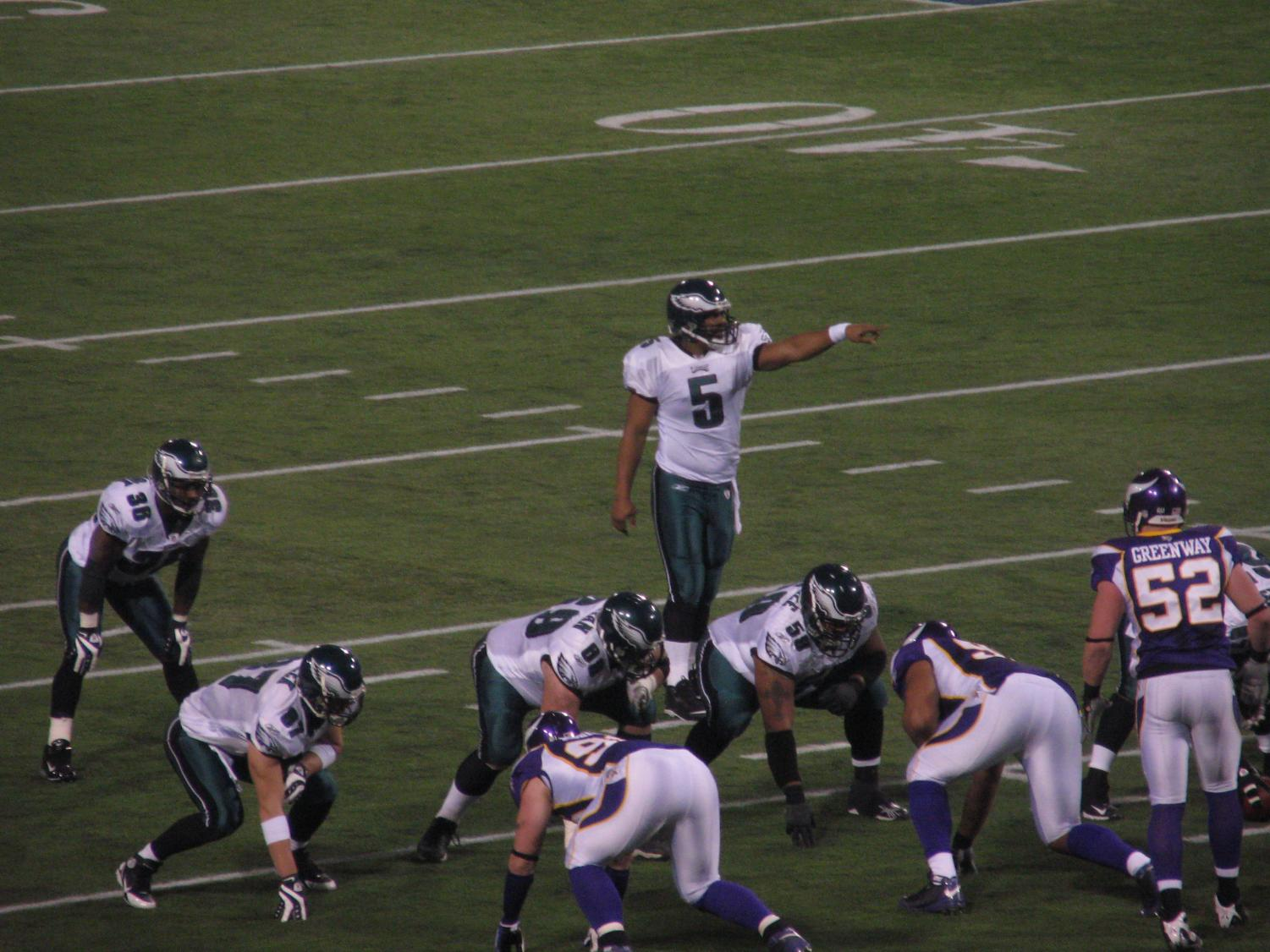 Seen here is Eagles legend Donovan McNabb (#5) calling an audible for the offense at the line of scrimmage.