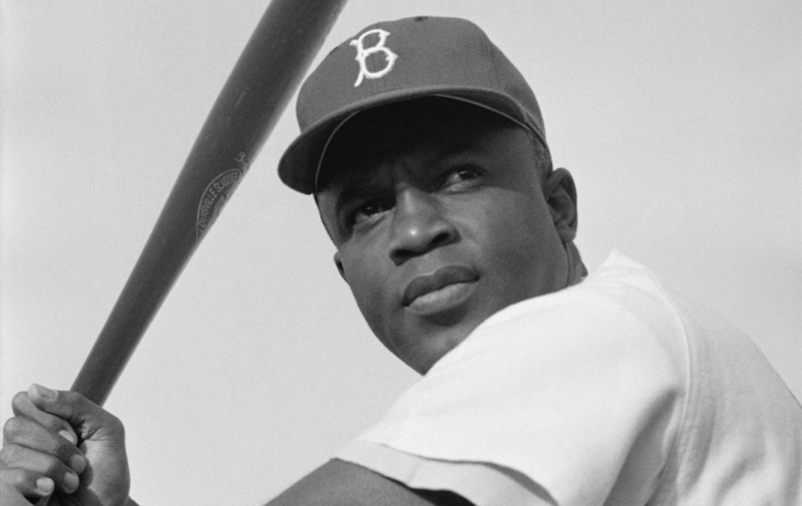 Seen here is the first African American to ever play in the MLB, Jackie Robinson, in his stance, ready to hit.
