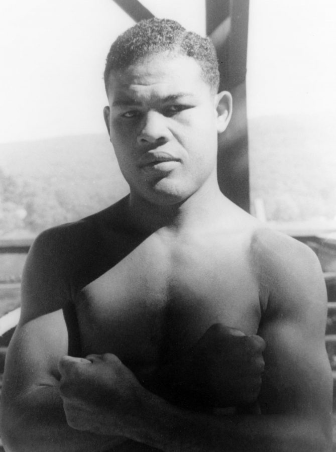 Seen here is Joe Louis posing for the camera in what seemed to be before a big fight.