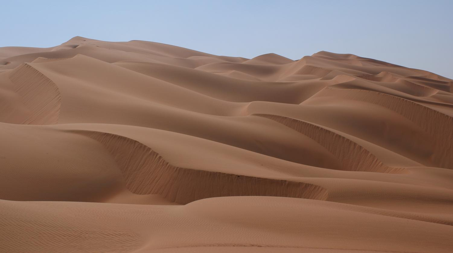 Parched means to be very dry, like in the desert.
