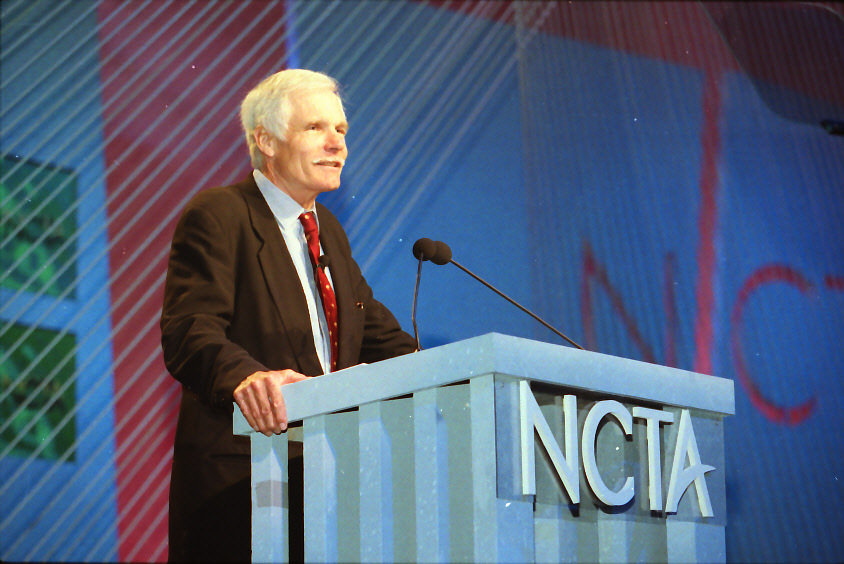 Seen here is billionaire businessman Ted Turner speaking for the NCTA (The Internet & Television Association).
