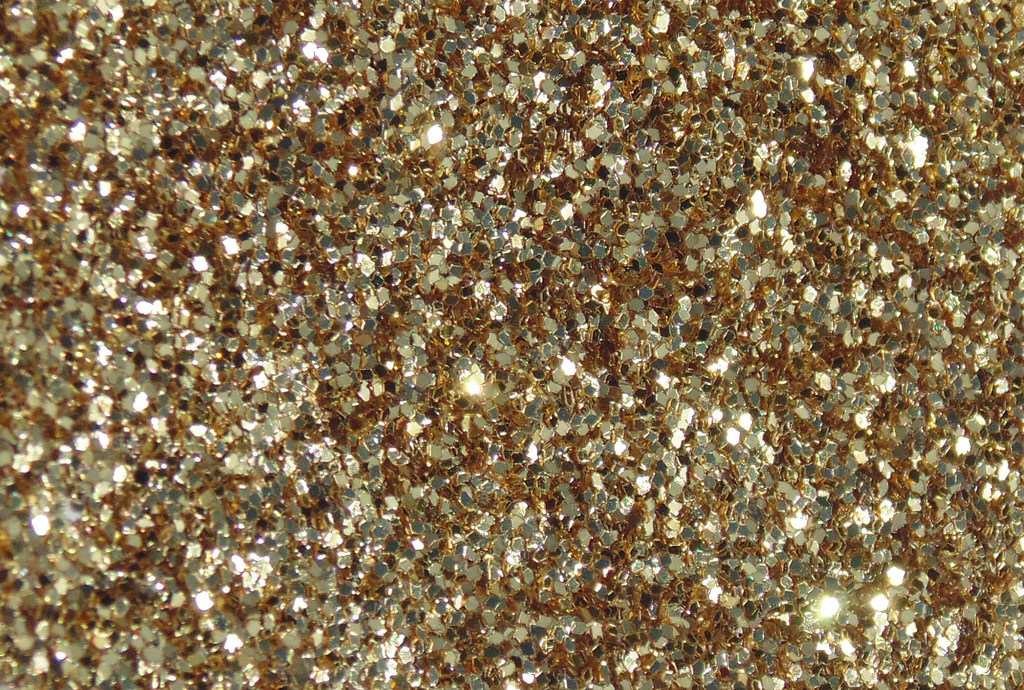 The reason humans are attracted to glitter is because it reminds us of water, they both shine and reflect.