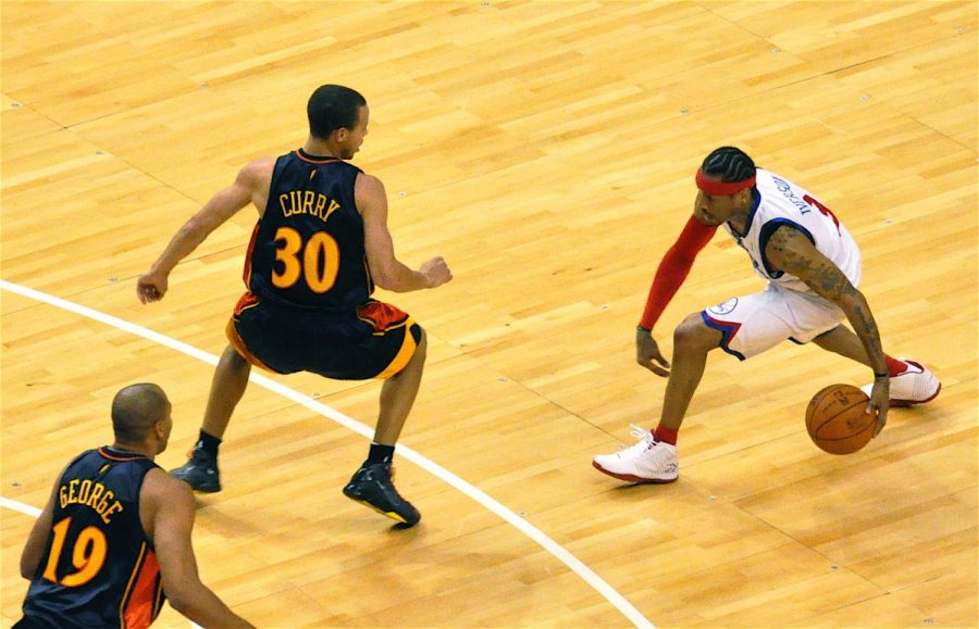 Seen here is Philadelphia 76ers guard Allen Iverson, who was the winner of the 2001 All-Star game MVP, driving on current NBA superstar Stephen Curry.