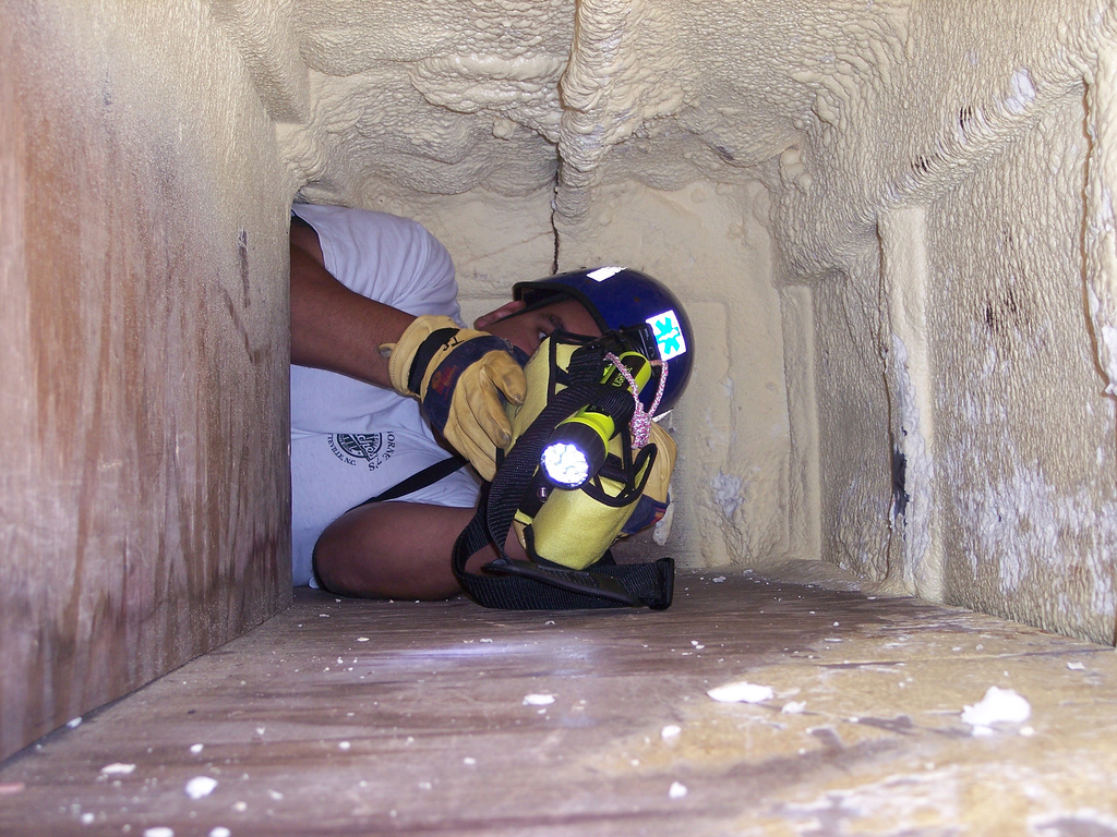 Being in a small, confined space such as a cave, can trigger Claustrophobia.