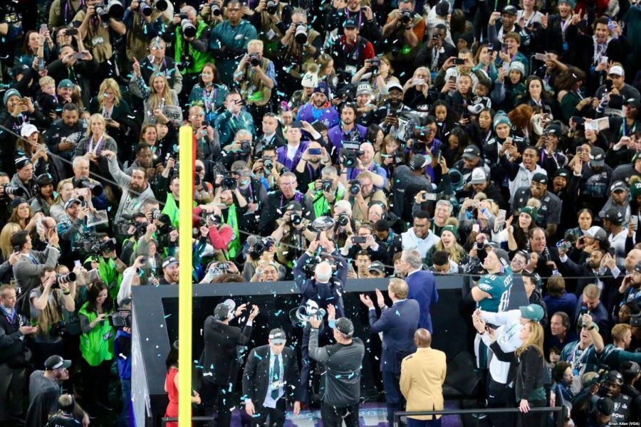 Seen here is a picture of the Philadelphia Eagles celebrating last year's Super Bowl win by holding out the trophy just moments after the actual game.