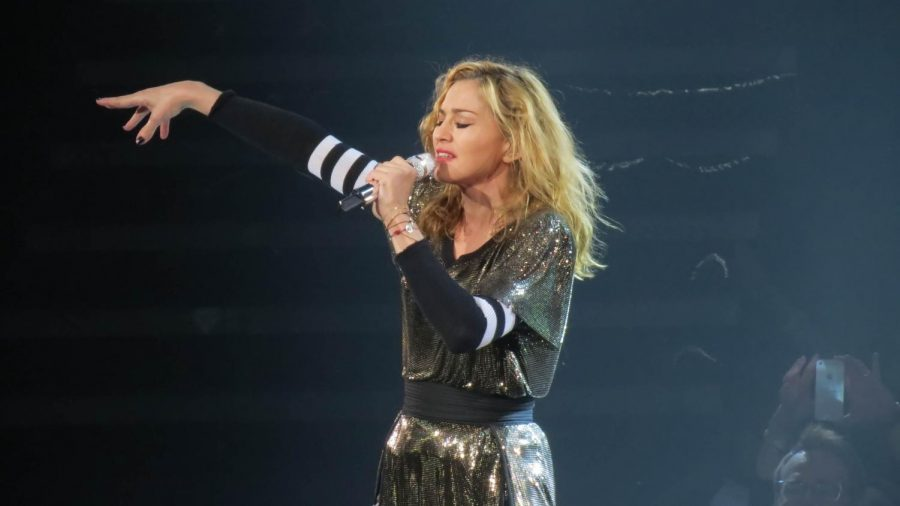 Passionately singing to the crowd, Madonna, sings Take a Bow.