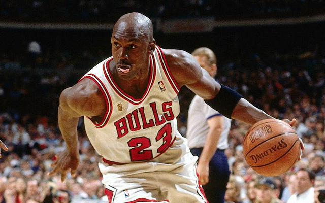 Seen here is a picture of NBA hall of fame member Michael Jordan driving to the basket as a member of the Chicago Bulls.