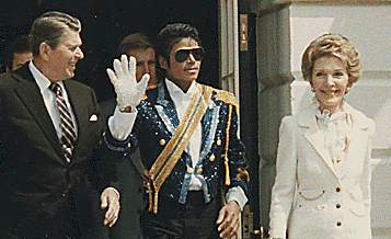Meeting the President due to his success, Michael Jackson, waves hello to fans.