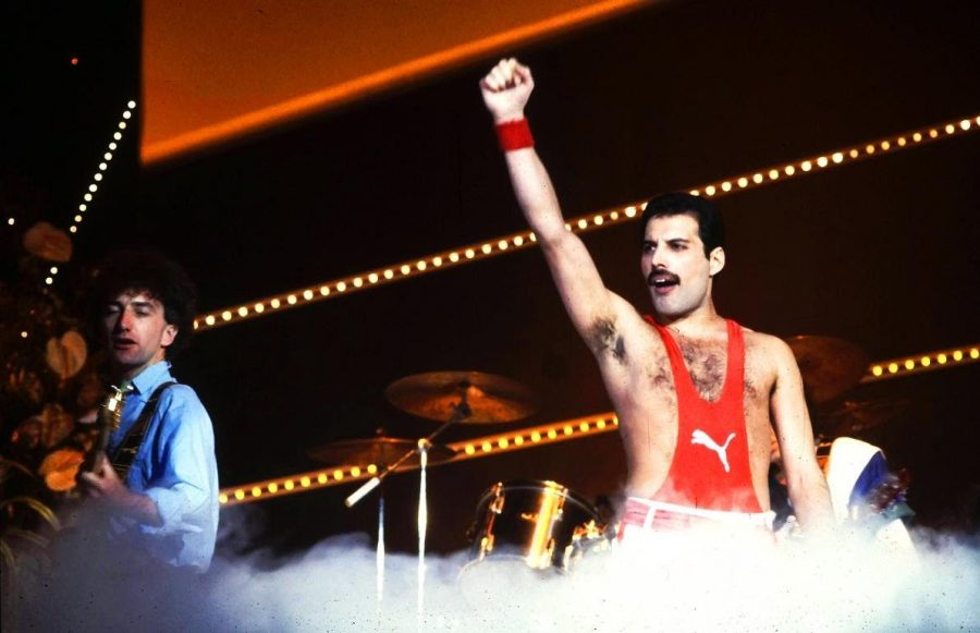 Performing at the concert, Freddie Mercury enjoys his time.