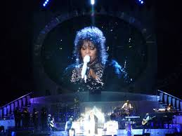 Performing I Will Always Love You, Whitney Houston breaks records.