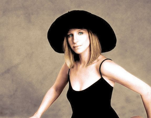 Posing for the camera, Barbra Streisand, makes history with her number one single.