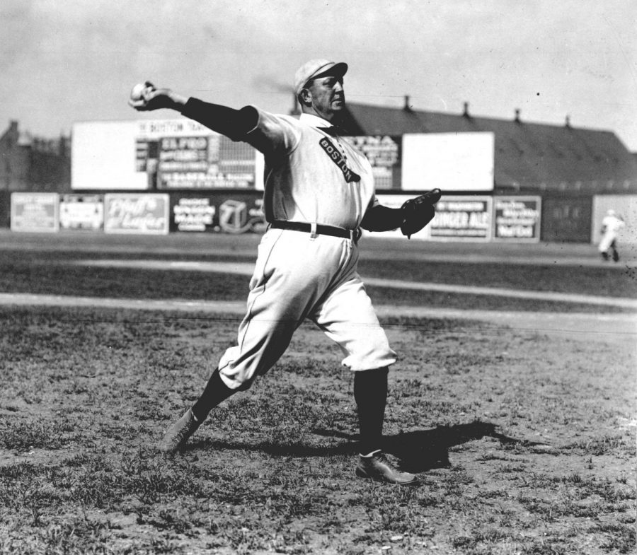 Seen here is hall of fame pitcher Cy Young, throwing before a game.