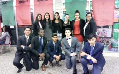 During a state-wide debate competition, Colonia's Patriots pose for a quick picture during break time.