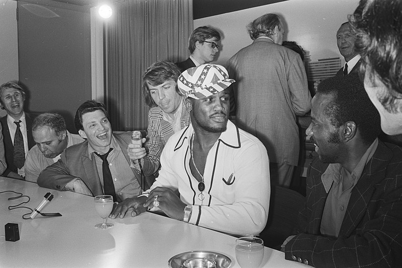 Seen here is boxing legend Joe Frazier at a press conference, answering questions, before one of his fights.