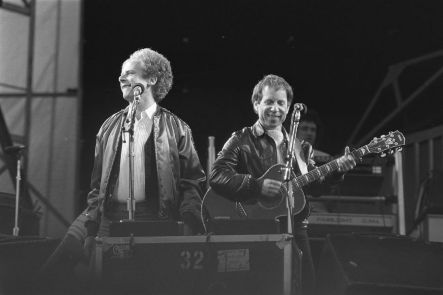 Performing together at the concert, the duo of Simon and Garfunkel sing Bridge Over Troubled Water.