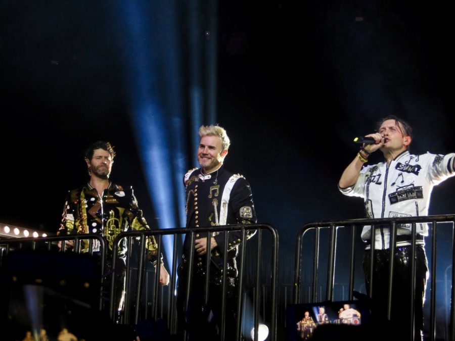 Singing their number one single Shine, Take That, performs in Glasgow.