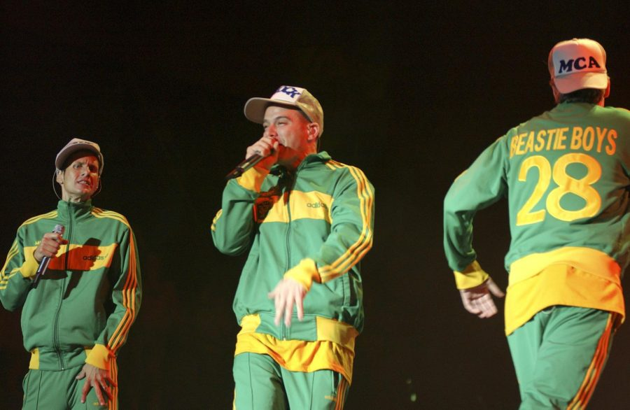 Rapping a song from their album, The Beastie Boys jam out at the concert.