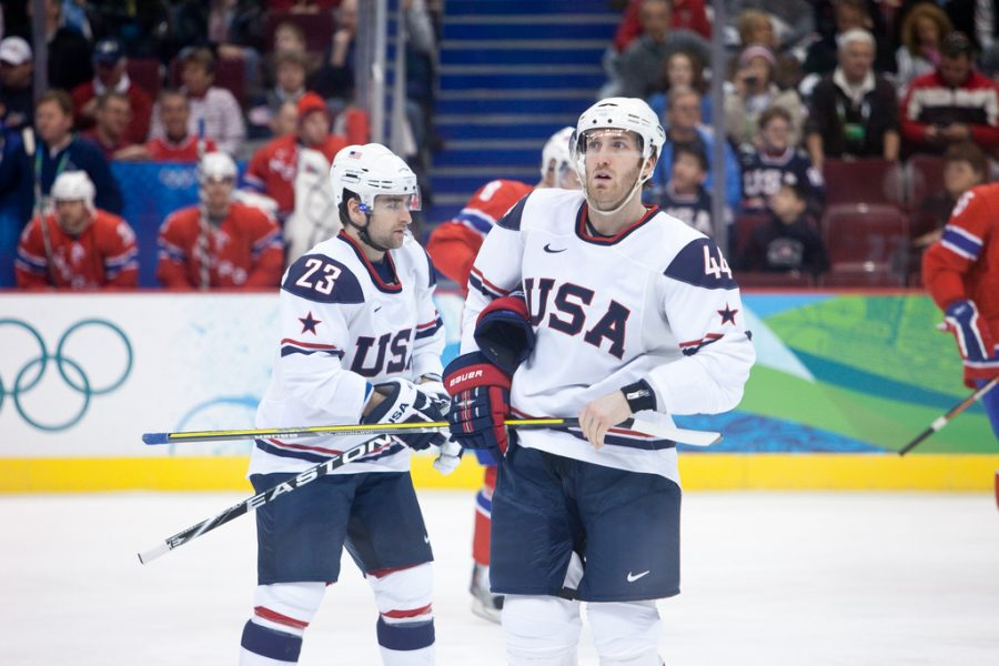Seen here are two members of the USA national hockey team, who went on to win their first gold medal in the sport back in 1960.