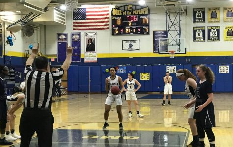 The lady Patriots face against the Zebra's of New Brunswick. Martinez takes a free throw for a Colonia point.