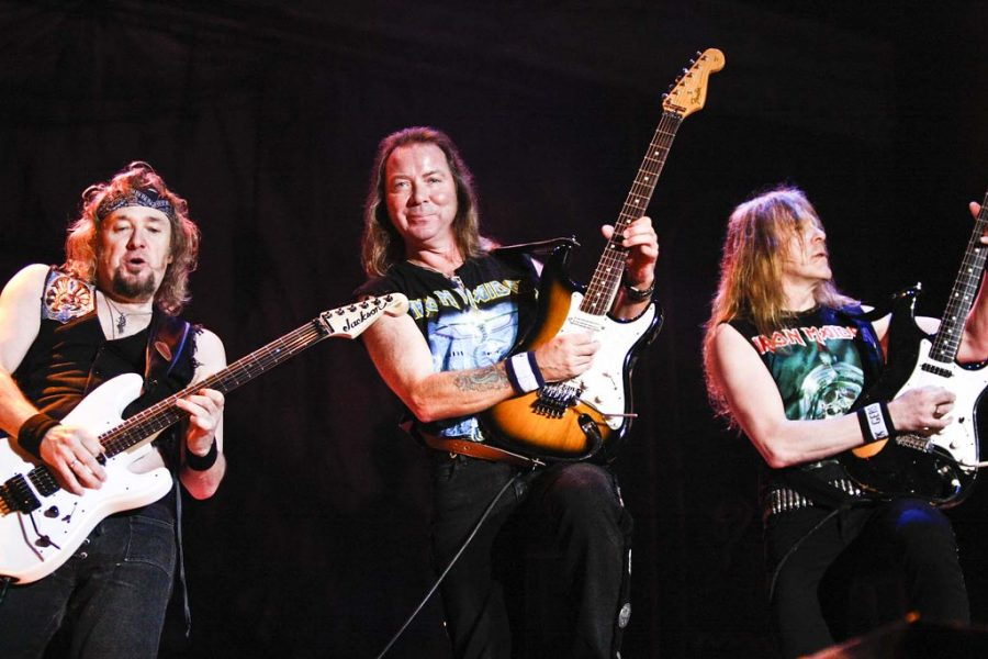 Jamming out with their guitar, Iron Maiden. perform in Costa Rica.