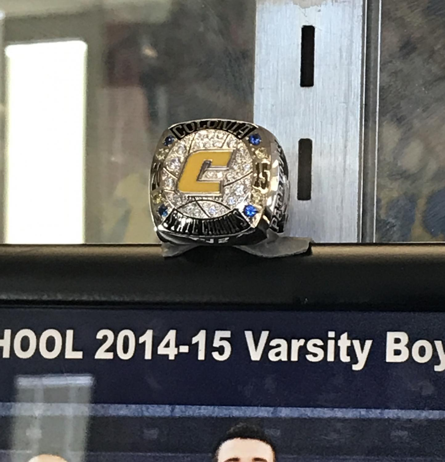 A photo of the 2014-2015 season ring. The ring sits in the trophy case in Colonia High Schools lobby.