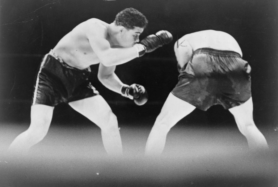 Seen here is heavyweight boxing legend Joe Louis (left) dominating his opponent, as he did throughout his whole career.
