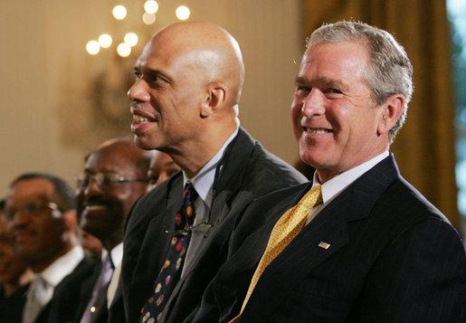 Seen here is the all-time NBA scoring leader, Kareem Abdul-Jabbar, talking to former President George H. W. Bush.
