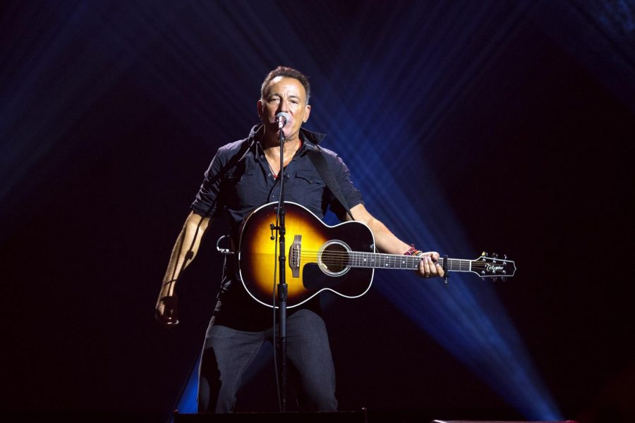 Performing at the concert, Bruce Springsteen sings from his album Devils and Dust.