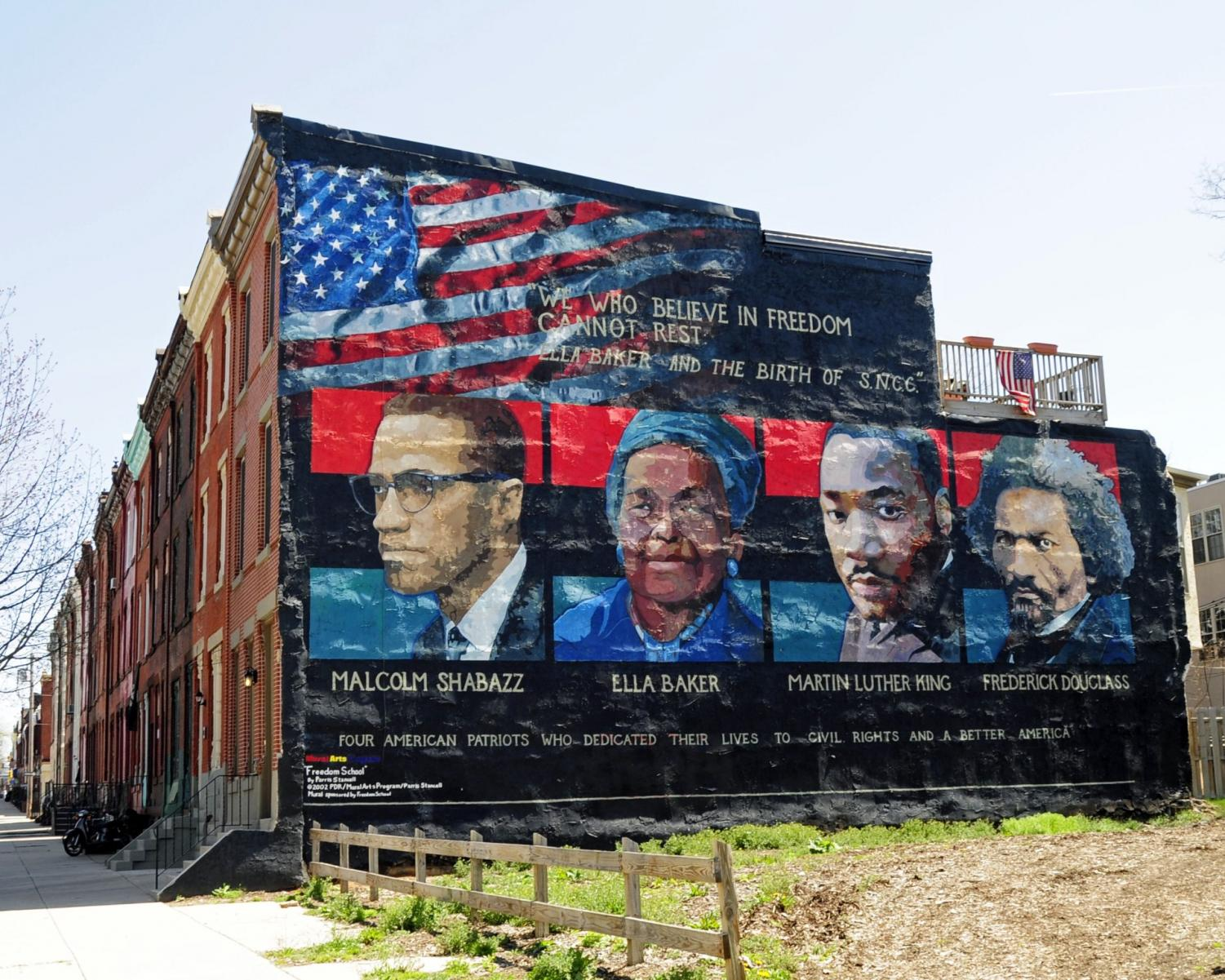 This is a mural on the wall of people including American Activist, Ella Baker.