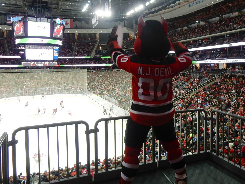 Seen here is the Devils mascot getting the crowd hyped up for one of their home games at the Prudential Center.
