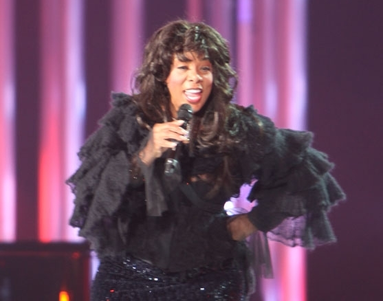 Singing one of her famous singles, Donna Summer performs at the concert.