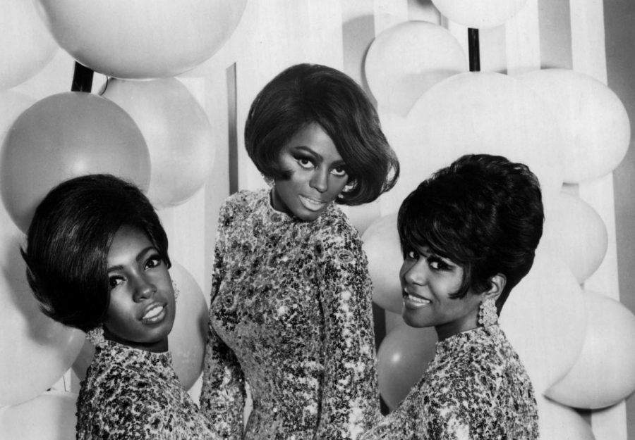 Attending a party for their single, The Supremes, are happy about their success.