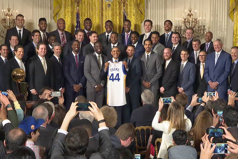 Seen here is the Golden State Warriors basketball team celebrating with President Barack Obama after winning the NBA championship in 2015.