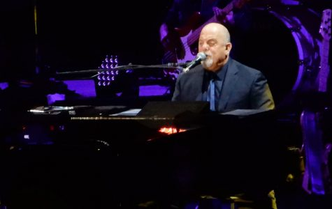 Playing the piano at the concert, Billy Joel performs for one of his songs from his album.