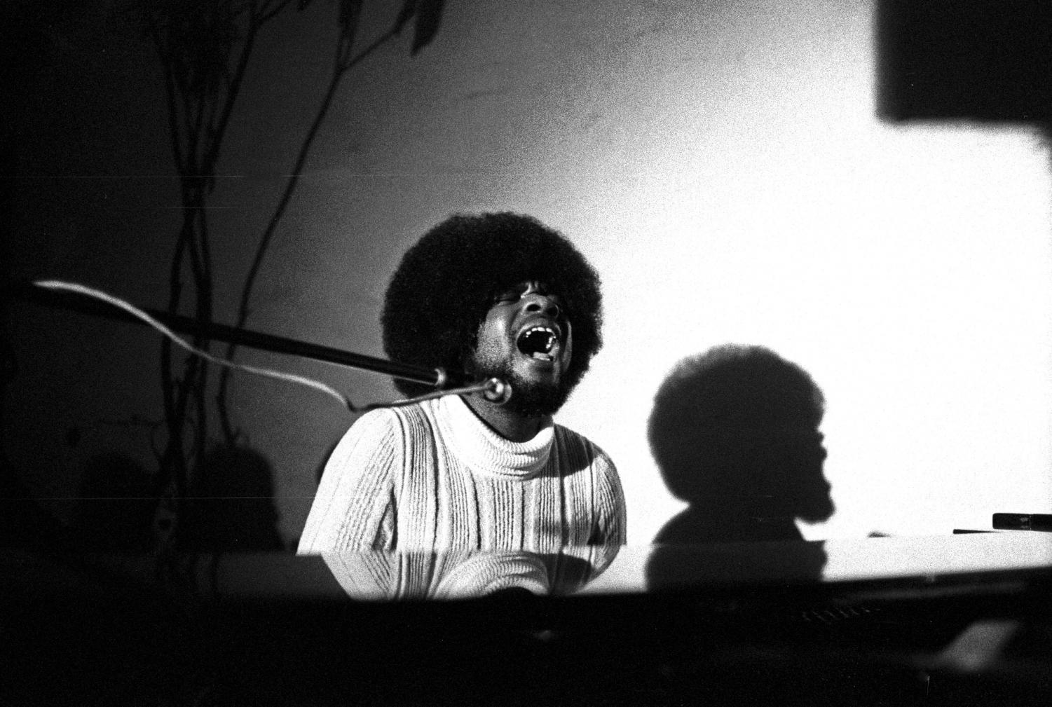 Passionately singing to one of his songs, Billy Preston plays the keyboard.