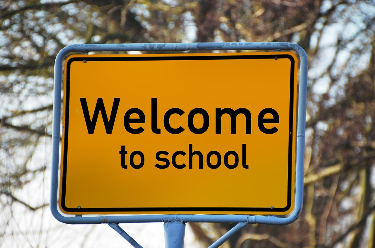 A creative way of welcoming students, a sign is posted before a school.