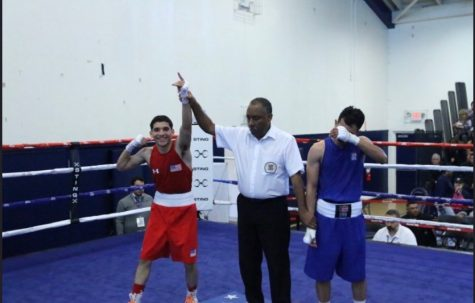 Jose  strikes a pose after his victory against his opponent