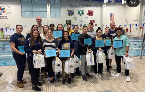 The senior swimming patriots with their build-a-bears and awards during their senior night ceremony.