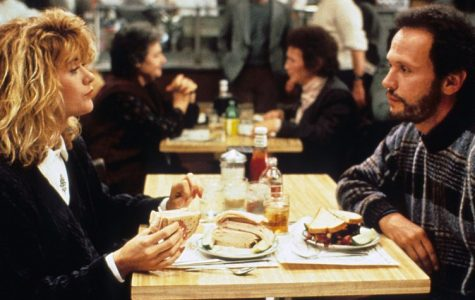 Meg Ryan as Sally and Billy Crystal as Harry are eating in a scene from the film. .