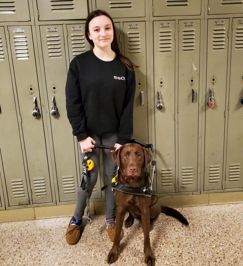 Roaming through the hallway, Riley Canas and Dakota get ready for class.