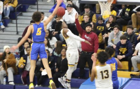 Colonia's Varsity Boys' Basketball wins a victory over North Brunswick
