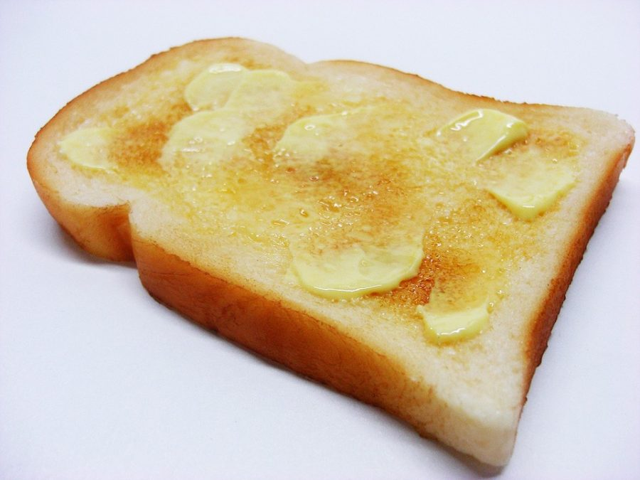 Buttered toast almost always falls on its side