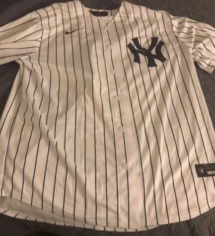 Several sports jerseys will be bought over this holiday season. The classic Yankee pinstripes will likely be one of them