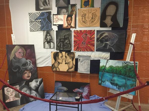 CHS art students usually showcase their work in the school lobby multiple times per year. The AP art students normally have the opportunity to put an exhibit together like the one seen in this photo.