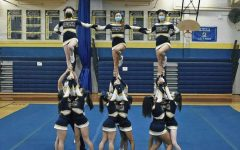 Performing a routine is Colonia High School's competition cheer team. Doing stunts like that requires much athletic ability, so it's important to stay in shape.