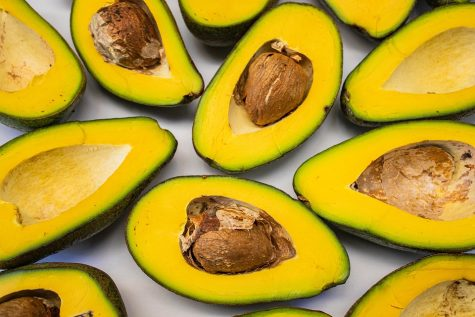 Pictured are half-cut avocados. They are not vegetables, believe it or not!
